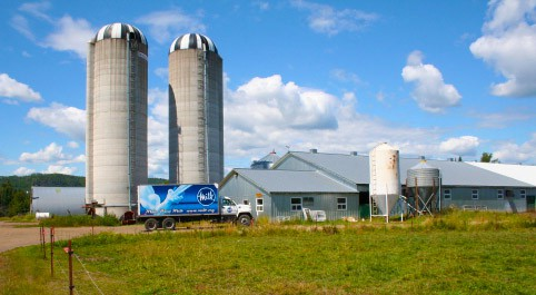 Slate River Dairy Farm with Milk Truck in font
